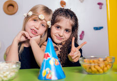 Little girls sitting and talking in the playroom Stock Photos