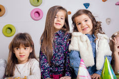 Little girls sitting and talking in the playroom Royalty Free Stock Photo