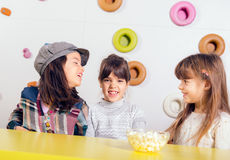 Little girls sitting and talking in the playroom Royalty Free Stock Photos
