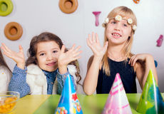 Little girls sitting and talking in the playroom Stock Photography