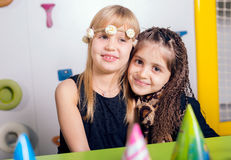 Little girls sitting and talking in the playroom Royalty Free Stock Images