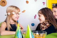 Little girls sitting and talking in the playroom Royalty Free Stock Photography
