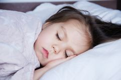 Little girls sleeping lying on bed. sleep schedule in domestic lifestyle. baby child. Little girls sleeping lying on bed. sleep schedule in domestic lifestyle royalty free stock photo