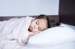 Little girls sleeping lying on bed. sleep schedule in domestic lifestyle. cute child. Little girls sleeping lying on bed. sleep schedule in domestic lifestyle royalty free stock photos