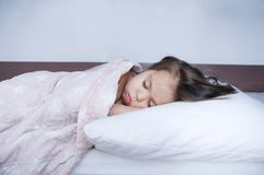 Little girls sleeping lying on bed. sleep schedule in domestic lifestyle. cute child. Little girls sleeping lying on bed. sleep schedule in domestic lifestyle royalty free stock photo