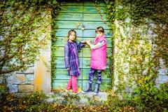 Little girls  standing in front of the doors Stock Image