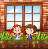 Little girls standing outside the house Royalty Free Stock Images