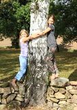 Little girls on stone wall Royalty Free Stock Photos