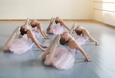 Little girls stretching together in ballet class. Little girls stretching together before performance in ballet class stock photography