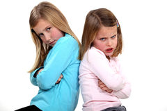 Little girls with sulky expression Royalty Free Stock Images