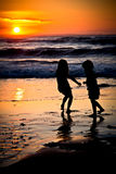 Little girls in a sunset Stock Images