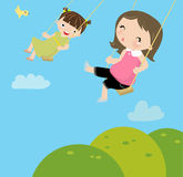 Little girls on a swing Royalty Free Stock Image