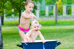 Little girls take a bath in vintage tube Royalty Free Stock Photography