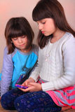 Little Girls Texting royalty free stock image