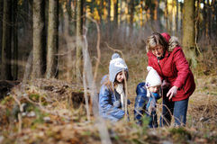 Little girls and their grandmother taking a walk in a forest Royalty Free Stock Photography