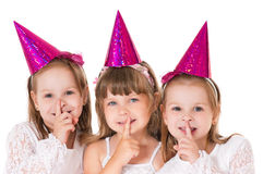 Little girls. Three cute little girls say silence is a secret Royalty Free Stock Photo