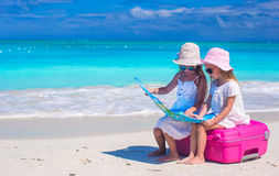 Little girls at tropical beach while summer Royalty Free Stock Images