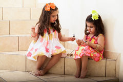Little girls trying some makeup on Stock Image