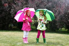 Little girls with umbrellas Royalty Free Stock Photography