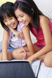 Little girls using laptop Stock Photo