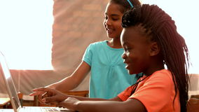Little girls using laptop in classroom stock video footage