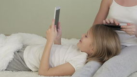 Little girls using tablet stock footage