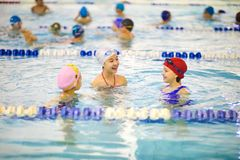 Little girls visiting swimming pool stock images