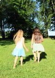 Little girls walking barefoot Stock Photo