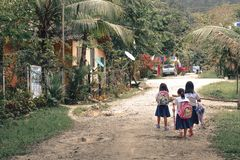 Little girls walking to primary school in Port Barton Palawan the Phillipines stock image