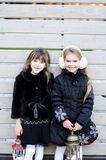 Little girls in warm outfit posing outdoors Royalty Free Stock Image
