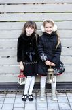Little girls in warm outfit posing outdoors Royalty Free Stock Photos