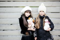 Little girls in warm outfit posing outdoors Stock Images