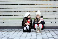 Little girls in warm outfit posing outdoors Stock Photo