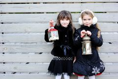 Little girls in warm outfit posing outdoors Stock Image
