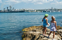Little girls watching for celebration of Russian Navy Day Royalty Free Stock Image