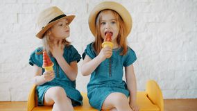 Little girls waving their hands and waiting for summer. Two little girls waving their hands and waiting for summer vacation stock video footage