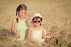 Little girls in wheat field Stock Image