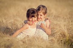 Little girls in wheat field Stock Photos