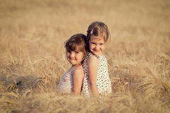 Little girls in wheat field Royalty Free Stock Image