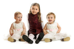 Little girls on white background. Cute little kids are sisters on white background royalty free stock image