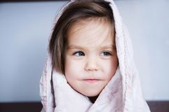 Little girls wrapped in blanket going to sleep sitting on bed. sleep schedule in domestic lifestyle. cute child portrait. Little girls wrapped in blanket going royalty free stock photography