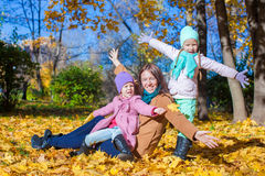 Little girls and young mother in autumn park have Royalty Free Stock Photos
