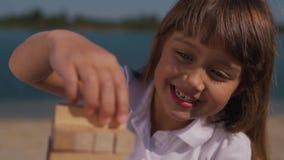 Little gitl plays jenga game stock video