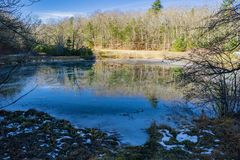 Little Glade Mill Pond - 3. Blue Ridge Parkway, NC – December 19th: A view of a frozen Little Glade Mill Pond located on the Blue Ridge Mountains at mile stock photo