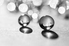Little glass balls in direct sunlight, macro. Abstract background, black and white photo.  stock image