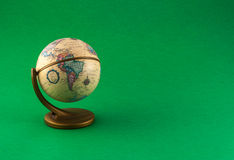 Little globe on colored background Stock Photo