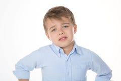 Little glum kid. Sad boy begging for something Royalty Free Stock Photography