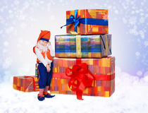 Little gnome with christmas gift boxes Stock Photography