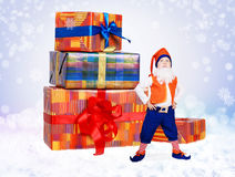 Little gnome stand near christmas gift boxes Royalty Free Stock Image