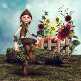 Little gnome and sunflowers Royalty Free Stock Photography